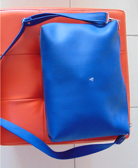 Blue medium size sling bag with long handle to put over the shoulder
